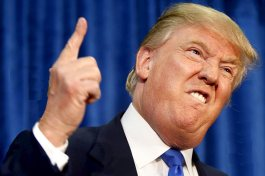 trump finger in air biting lip